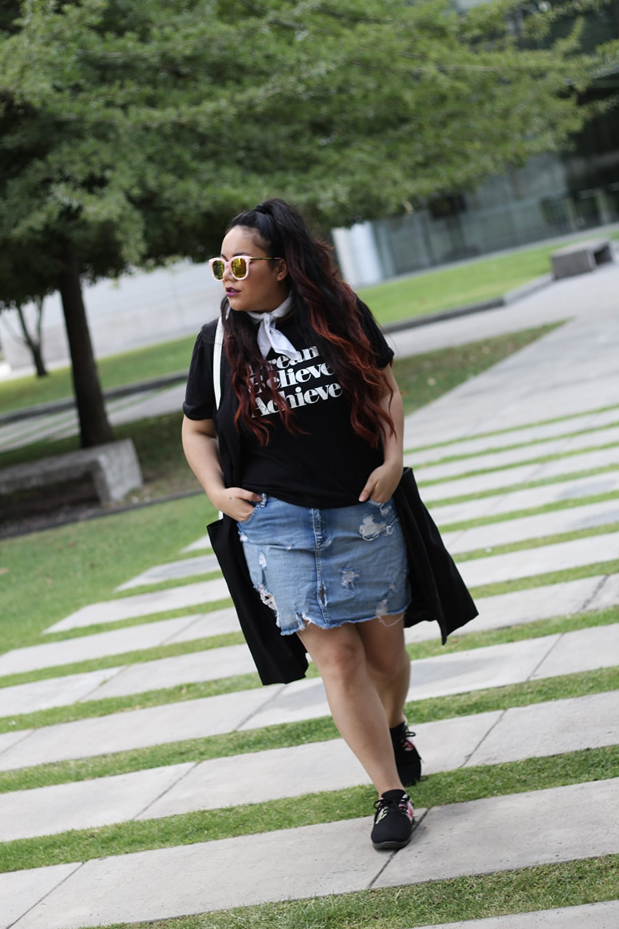 Graphic tee and tropical sneakers festival season outfit inspiration curvy
