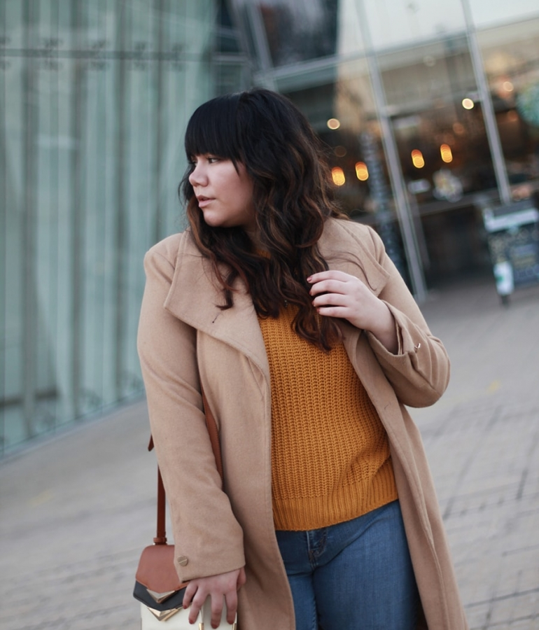 Long nude coat and a mustard sweater