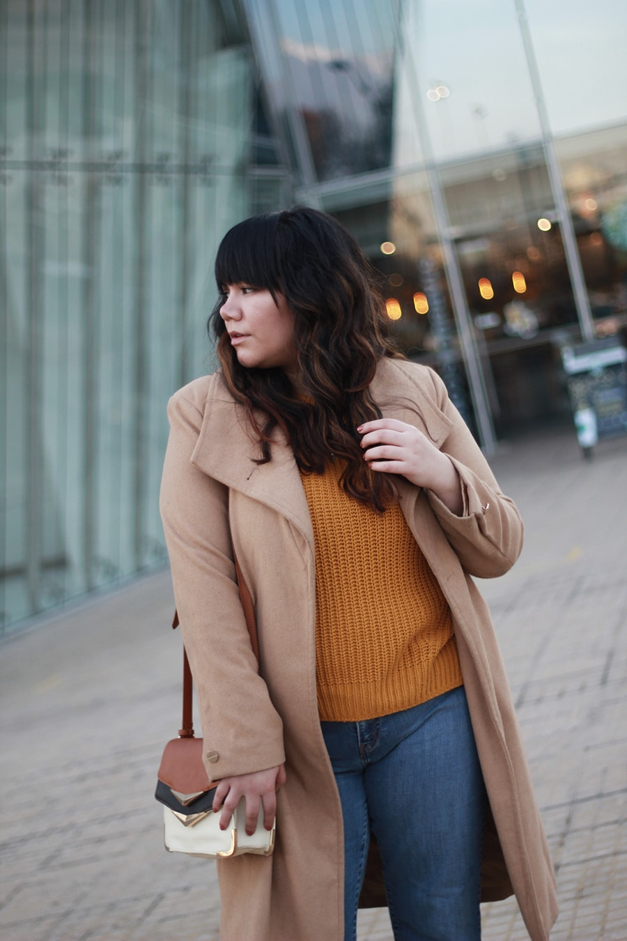 Nude long coat - mustard sweater top - camel boots - winter outfit ideas curvy plus size