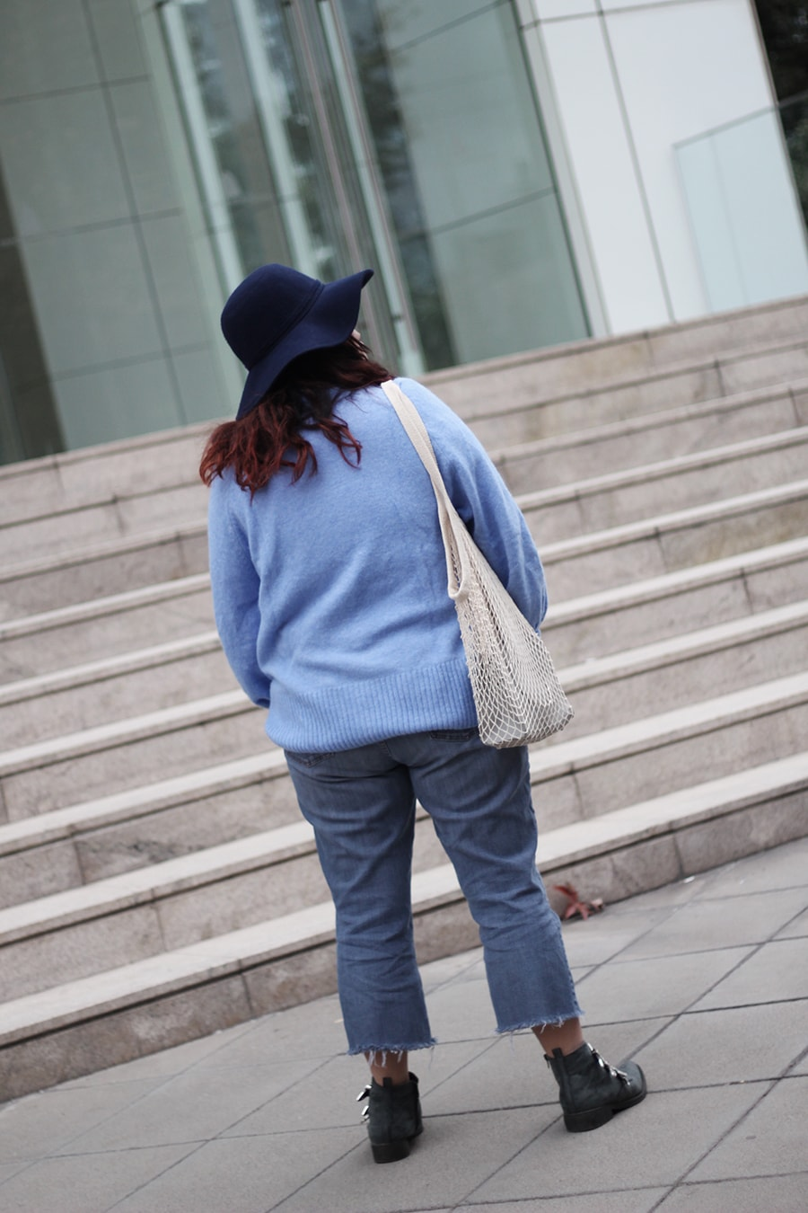 Blue turtle neck sweater - net bag trend - cowboy boots - plus size winter outfit
